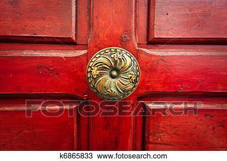 Stock Photo of Brass doorknob and red door k6865833 - Search Stock ...