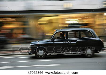 banque d 39 images londres taxi k7062366 recherchez des photos des images des photographies. Black Bedroom Furniture Sets. Home Design Ideas