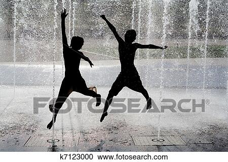 Stock Photography Of Silhouette Kids Jumping In Cool Fountain