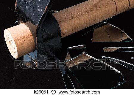 Stock photography of hammer broken mirror pieces on a for What to do with broken mirror pieces
