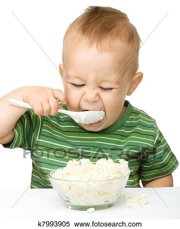 Stock Image Of Little Boy Is Eating Cottage Cheese Using Spoon