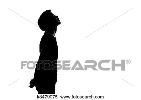 stock image of one young teenager boy or girl looking up