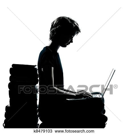 stock photo one caucasian young teenager silhouette boy or girl sitting computer computing laptop books
