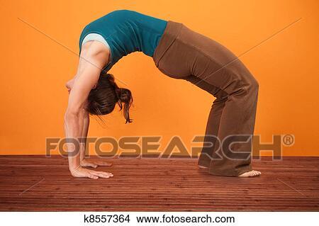 Stock photo of urdhva dhanurasana yoga pose k8557364 for Pose poster mural