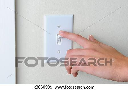 Stock Image Of Woman Turning Off Light Switch K8660905