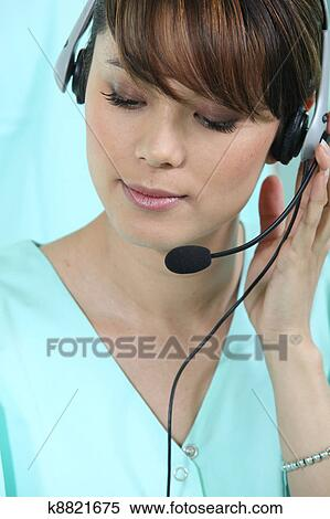 Stock Image of Medical secretary with headset k8821675 - Search ...