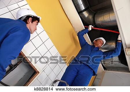 Stock photo of workers working on air conditioning for Air conditionn mural