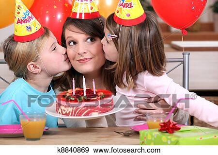 Stock Photograph Of Sisters Kissing Mom At Birthday S