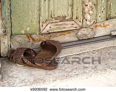 Stock Photo - Plastic slippers at the doorstep. Fotosearch - Search Stock Photography, Print Pictures, Images, and Photo Clip Art