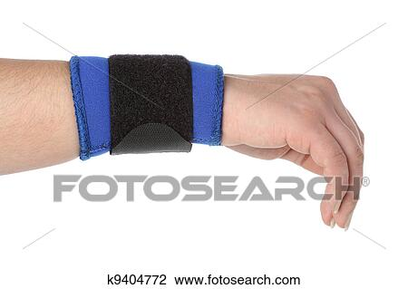 stock photo of human hand with a wrist brace orthopedic equipment over white k9404772 search. Black Bedroom Furniture Sets. Home Design Ideas
