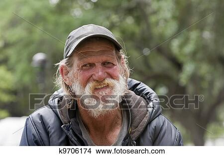 Stock Photo of Happy Homeless Man k9706174 - Search Stock ...