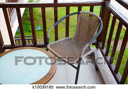 Stock image of wicker chair on the balcony k10039185 - searc.