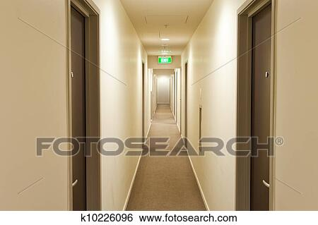 Stock Images Of Long Corridor With Hotel Room Doors And Exit Sign K10226096 Search Stock