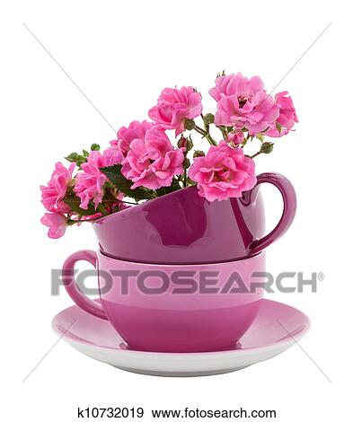 stock fotograf kaffeetassen mit rosafarbene rosen k10732019 suche stock fotografie poster. Black Bedroom Furniture Sets. Home Design Ideas