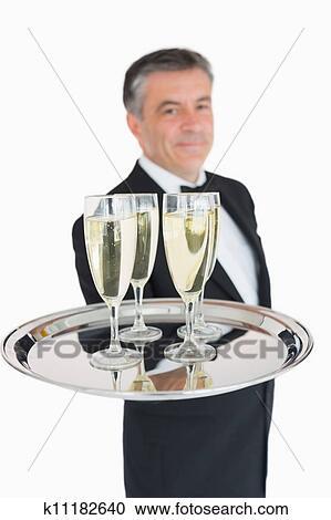 stock fotografie kellner besitz tablett mit champagner k11182640 suche stockfotografien. Black Bedroom Furniture Sets. Home Design Ideas