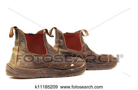 Stock Photograph of Old worn out leather dirty work boots ...