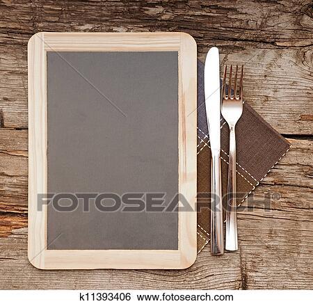 stock bilder men karte tafel liegen auf alt holztisch mit messer gabel k11393406. Black Bedroom Furniture Sets. Home Design Ideas