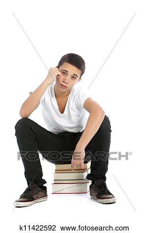 Stock Photo of Dejected teenaged boy with his textbooks ...