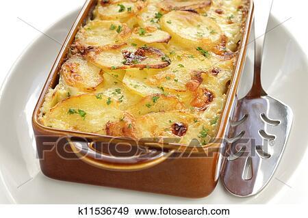 Banque de photographies pomme terre gratin k11536749 for Cocinar patatas al horno