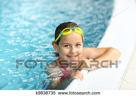 Stock image of girl with goggles in swimming pool k9838735 for Cute pool pictures