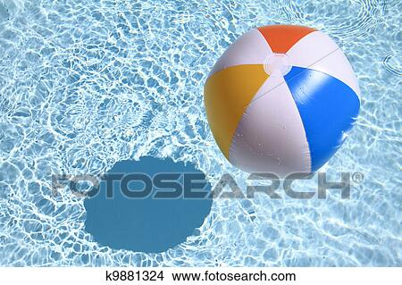 Swimming Pool Beach Ball Background stock photo of summer background. beach ball on the swimming pool