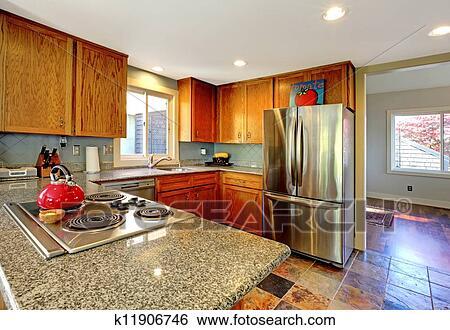 stock bilder kueche mit herd und rot tee pot k11906746 suche stockfotografie. Black Bedroom Furniture Sets. Home Design Ideas