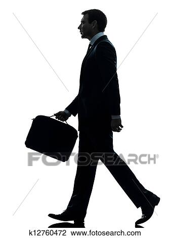 Stock Photo of business man walking profile silhouette ...