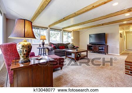 bild wohnzimmer innere mit mauerstein kaminofen holz balken und red k13048077 suche. Black Bedroom Furniture Sets. Home Design Ideas