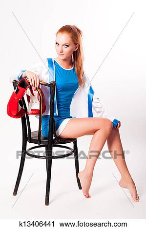 Stock Photography - Pretty girl with boxing gloves on chair. Fotosearch -  Search Stock Photos