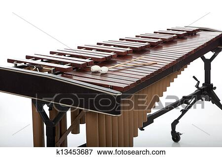 Picture of A brown wooden marimba on a white background ...