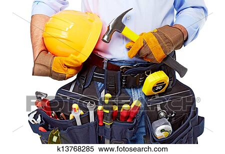 Stock Image of Worker with a tool belt. Construction ...