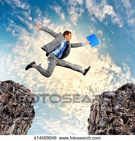 Stock illustration of businessman jumping over gap for Jump the gap