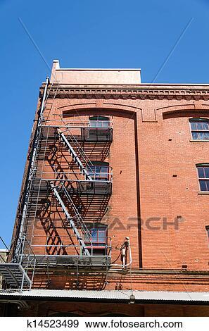 Stock Photograph Of Brick Building Fire Escape K14523499