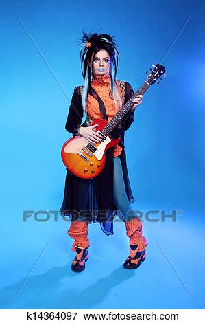 Picture Of Rock Girl Posing With Electric Guitar Playing Hard
