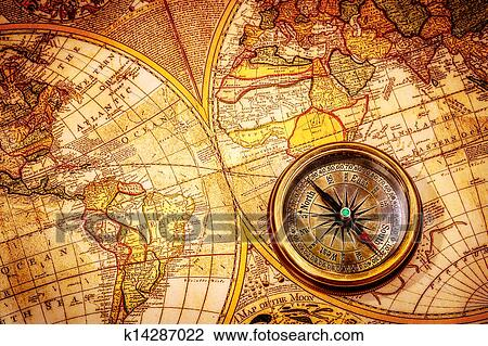 Stock photo of vintage compass lies on an ancient world map stock photo vintage compass lies on an ancient world map fotosearch search gumiabroncs Image collections
