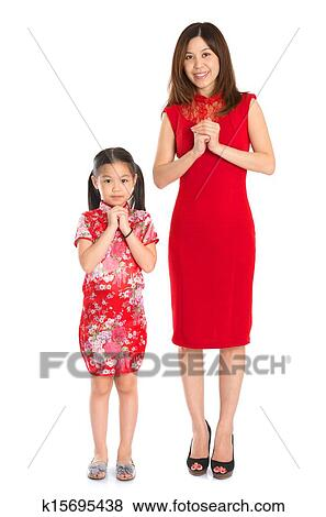 Pictures of full body chinese parent and child greeting to each happy chinese new year full body chinese parent and child in traditional chinese cheongsam greeting to each other isolated on white background m4hsunfo
