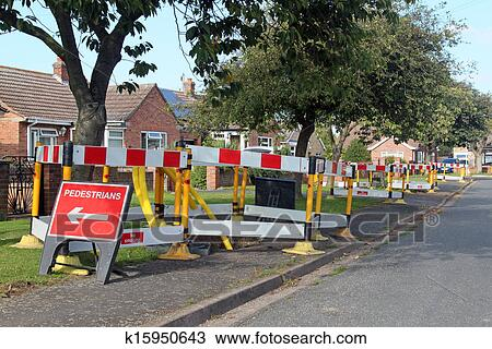 stock photo of road work warning signs and barriers in a