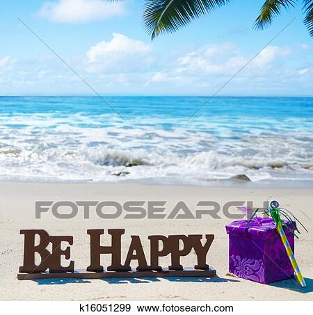 Stock Photograph of Sign Be Happy with Birthday decorations on
