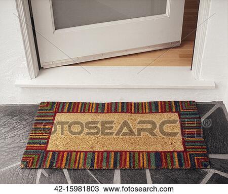 Stock Photo - Welcome Mat at Open Door  Fotosearch - Search Stock    Open Door Welcome Mat