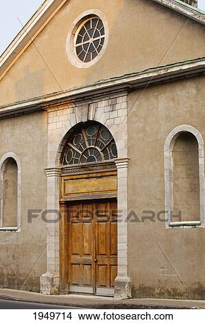 Stock Photo of front doors of an old church building; trois ...
