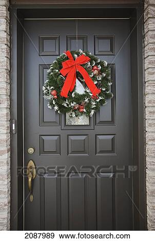 Christmas Front Door Clipart stock photograph of christmas wreath on the front door of a