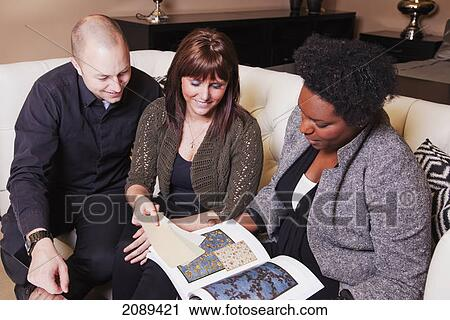 Stock Photography of Young couple shopping for furniture with
