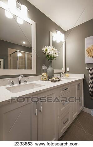 Stock photo of a contemporary bathroom with double sinks for Bathroom cabinets surrey bc