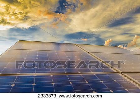 banque de photo panneaux solaires photovolta que talage t coucher soleil nuages. Black Bedroom Furniture Sets. Home Design Ideas