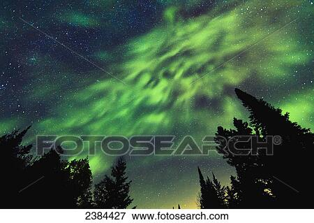 Picture of Aurora Borealis and milky way visible in the sky, Mont ...