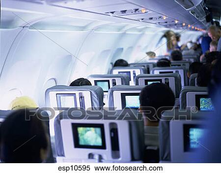 Banque d 39 image passagers int rieur avion regarder for Interieur d avion