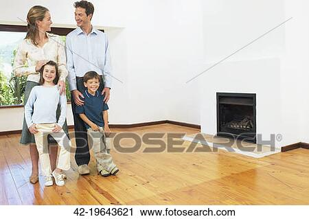 Stock Photography Of Family Standing Together In Empty Living Room 42 19643621 Search Stock