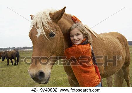 Girl Hugging Horse Girl Hugging a Horse