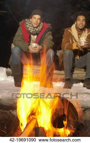 Stock Photography Of Two Men Sitting Around Campfire 42