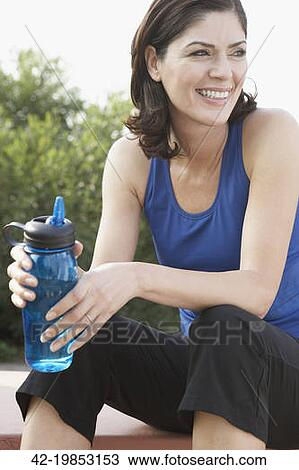 Stock Photo of Woman holding water bottle 42-19853153 ...